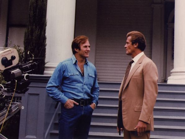With Roger Moore
